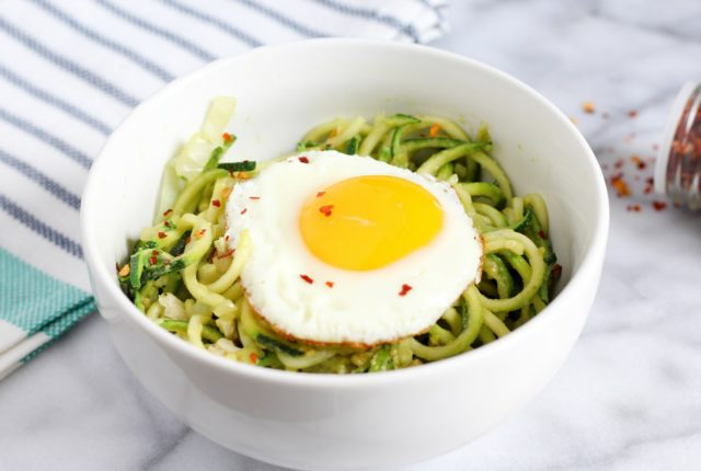 Avocado Zoodle Reciepe topped with an Egg and Red Pepper Flakes