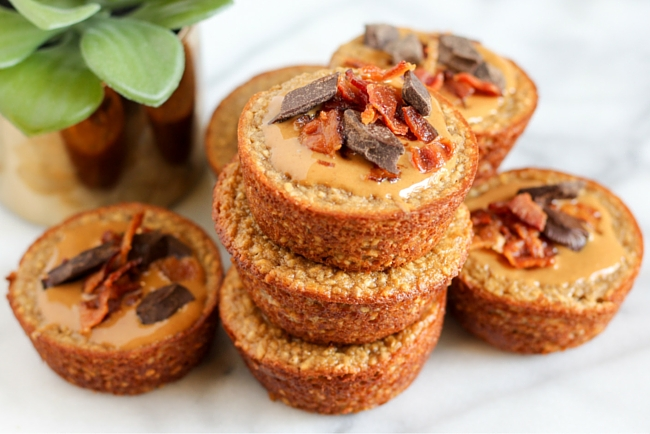 These Elvis Muffins are stuffed with peanut butter, oats, and topped with bacon, chocolate chips, and more peanut butter! Get the recipe here.